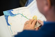 A participant has opened a booklet which contains an illustration of the Tidal Elbe - One of the estuaries in Europe